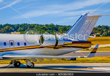 Private Jet Engine and Tail stock photo, The tail and engines of a nice private corporate jet by Darryl Brooks