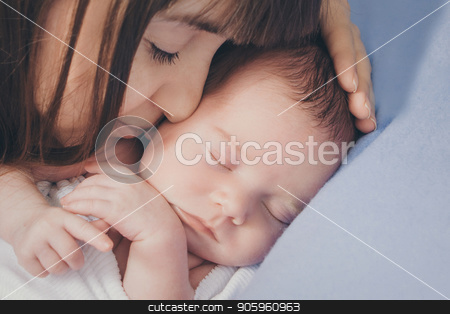 the woman pressed herself against the baby's face. Close-up portrait of a sleeping mother and child stock photo, the woman pressed herself against the baby's face. Close-up portrait of a sleeping mother and child by aaalll3110