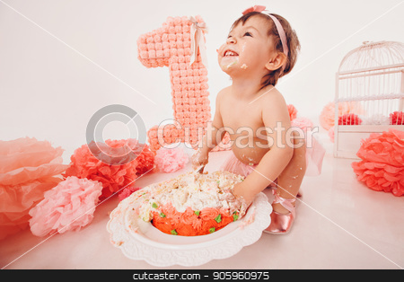 a little girl eats cake with her hands. The baby was covered in food. isolated white background. birthday party stock photo, a little girl eats cake with her hands. The baby was covered in food. isolated white background. birthday party by aaalll3110