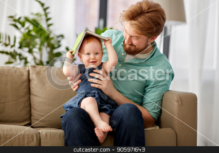 father and baby daughter playing with book at home stock photo, family, fatherhood and people concept - happy red haired father and little baby daughter playing with book at home by Syda Productions
