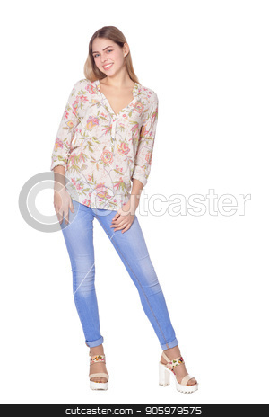 d5ae3122a2 beautiful woman in blue jeans posing on white background stock photo