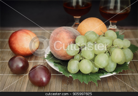 Still life: wine by the glass and fruit. stock photo, Still life: on the table on a plate are fruits, next to two glasses of wine. by Georgina198