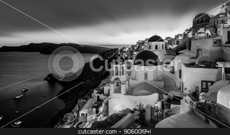 Traditional greek village of Oia in black and white, Santorini island, Greece. stock photo, Black and white cityscape of Oia, traditional greek village with blue domes of churches, Santorini island, Greece at dusk. by kasto
