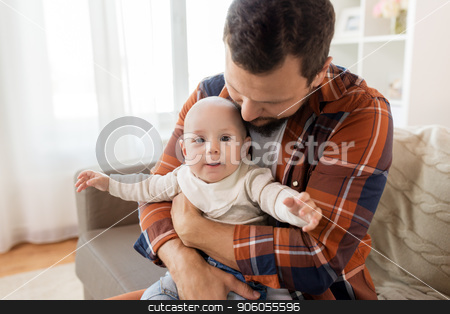 close up of father with little baby boy at home stock photo, family, parenthood and people concept - happy father with little baby boy at home by Syda Productions