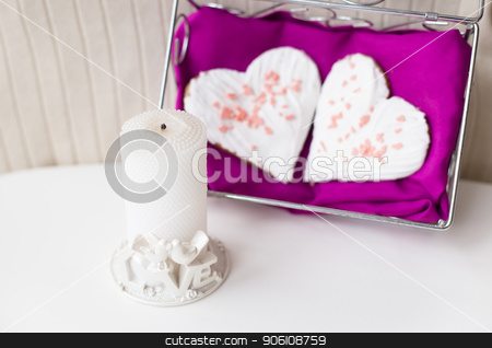 candle and biscuits in the form of heart on a pink napkin stock photo, candle and biscuits in the form of heart on a pink napkin by Sergiy Artsaba