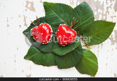 Belgian waffles with blackberry stock photo, Dessert in the form of heart lies on green leaves on an old wooden background, close-up. by Sergiy Artsaba