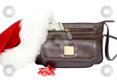 Holiday spending  stock photo, Purse with money bow and santa hat by John Teeter