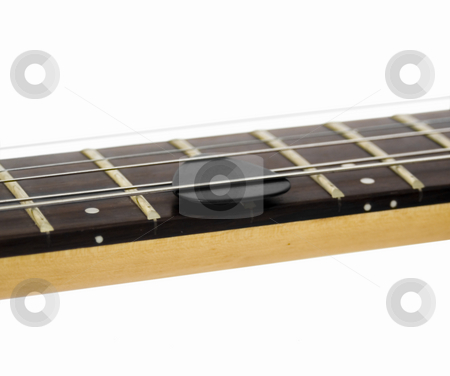 Guitar pic in strings stock photo, Guitar pic in strings by John Teeter