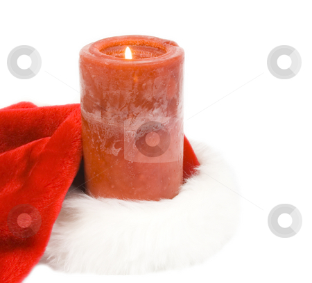 Candle in santa hat stock photo, Candle burning in santa hat by John Teeter