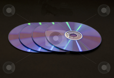 Row of 4 dvd cds stock photo, Row of 4 multicolored dvd cd media by John Teeter