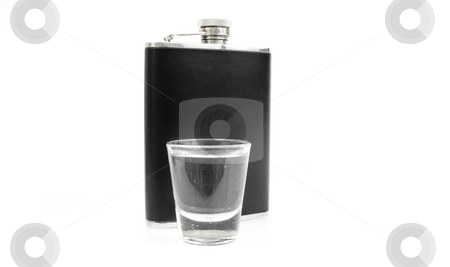 Shot glass and flask stock photo, Shot glass and flask on white by John Teeter