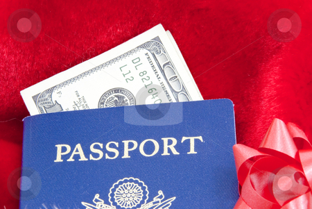 Holiday traveling with passport stock photo, Holiday traveling with passport and money by John Teeter