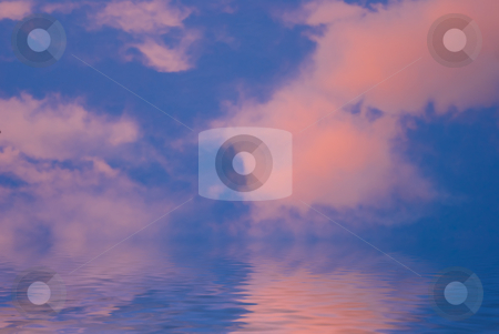 Pink clouds with water stock photo, Pink clouds with blue sky and water by John Teeter