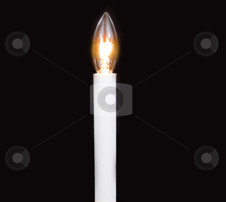 Lit Candle bulb stock photo, Lit candle bulb on black by John Teeter