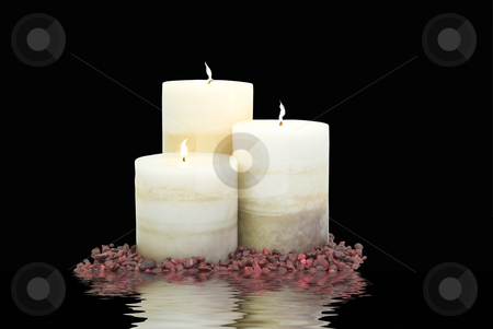 Three candles with water stock photo, Three lit candles on water by John Teeter