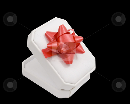 Jewelry box gift stock photo, Jewelry box gift with bow on black background by John Teeter
