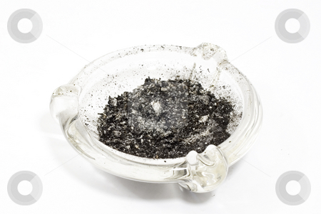 Glass Ash tray stock photo, Glass ash tray with ashes by John Teeter