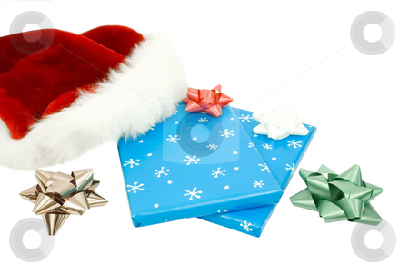 Christmas presents isolated stock photo, Christams presents with bows and santa hat by John Teeter