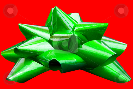 Green bow isolated stock photo, Green bow isolated on red background by John Teeter