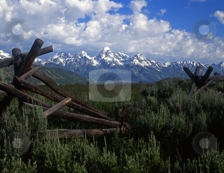 Fence and Tetons stock photo, A buck and rail fence and the Teton Mountain Range in Grand Teton National Park, Wyoming. by Mike Norton