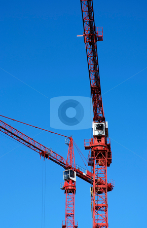 Cranes working stock photo, Two cranes working high above city by Paul Phillips
