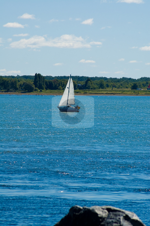Little sail boat stock photo, A little sail boat sailing on the river by Jean Larue-Frechette