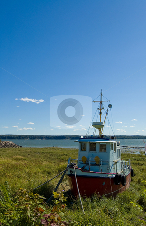 Fishing Boat stock photo, Small fishing boat anchored on the ground by Jean Larue-Frechette