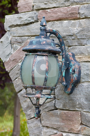 Old Lantern stock photo, Old lantern hooked on a stone wall by Jean Larue-Frechette