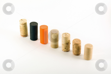 Cork row 2 stock photo, A variety of different wine cork standing arranged in a row by Jean Larue-Frechette