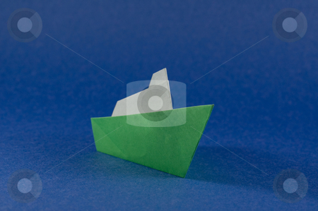 Origami boat stock photo, A green boat made of folded paper, origami craft. by Jean Larue-Frechette