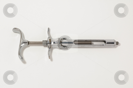 Old syringe stock photo, Close-up of an old style syringe isolated on white by Jean Larue-Frechette