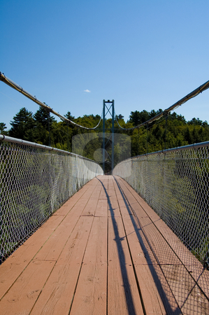 Long Pedestrian Bridge stock photo, Long bridge crossing a river in Coaticook canada by Jean Larue-Frechette