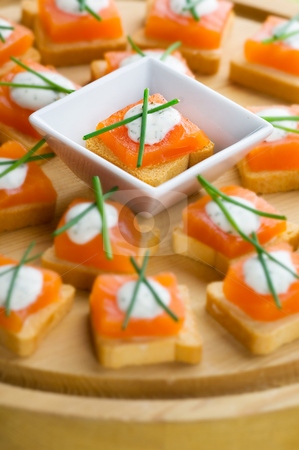 Appetizers stock photo, Delicious appetizers with smoked salmon and dille sauce. by Tommy Maenhout