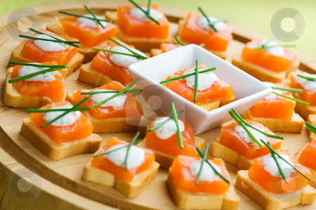 Appetizers stock photo, Delicious appetizers with smoked salmon and dill sauce by Tommy Maenhout