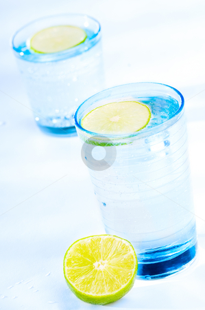 Refreshing drink stock photo, Cool and refresching drink with a slice of lime by Tommy Maenhout