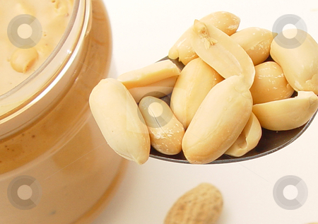 Peanut Butter Crunch stock photo, Spoonfull of fresh roasted peanuts by Jack Schiffer