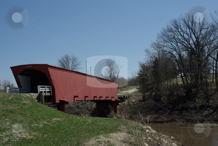 Old Covered Bridge stock photo, The Holliwell Bridge was built in 1880 in southcentral Iowa near Winterset, Iowa by Benton Jones.  Winterset has six covered bridges dating to the late 1800s.  The Holliwell Bridge and the Roseman Bridge were featured in the novel and movie,