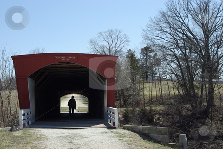 Old Covered Bridge stock photo, The Holliwell Bridge was built in 1880 in southcentral Iowa near Winterset Iowa by Benton Jones.  Winterset has six covered bridges dating to the late 1800s.  The Holliwell Bridge and the Roseman Bridge were featured in the novel and movie