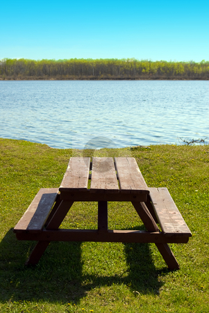 Picnic Table At The Beach stock photo, A wooden picnic table sitting in the grass, near the beach by Richard Nelson