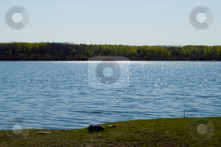 Small Lake stock photo, Landscape view of a small lake with the sun shimmering on the water by Richard Nelson