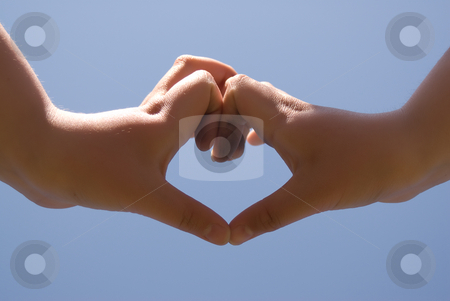 Love stock photo, A young girl's hands making a heart shape in the sky by Richard Nelson