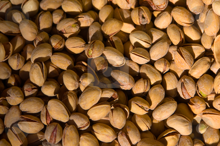 Roasted pistachios stock photo, Closeup of pistachio nuts that are still in the shell. by Wolfgang Heidasch