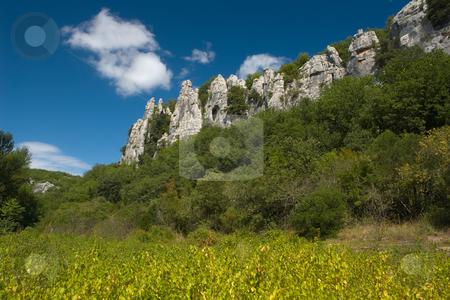 Cliffs in Chassezac stock photo, Der Chassezac ist ein Zufluss der Ard?che in S?dfrankreich. Er entspringt in den Cevennen in der N?he von Le Moure de la Gardille. Bei Ruoms m?ndet er in die Ard?che. Typisch ist das steile Tal, welcher in den Jahrtausenden in den Stein gegraben hat. Fluss und Tal sind heute ein Eldorado f?r Kletterer und Kanufahrer. by Wolfgang Heidasch