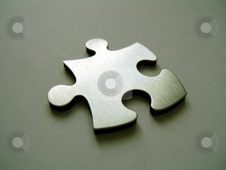 Metallic jigsaw stock photo, Metallic jigsaw puzzle on a metallic background by Gautier Willaume