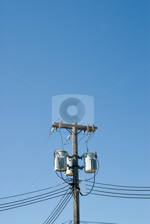 Powerline stock photo, Powerline transformers shot against a blue sky, with additional room for text by Richard Nelson