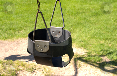 Baby Swing stock photo, Close-up of a black baby swing shot in the park by Richard Nelson