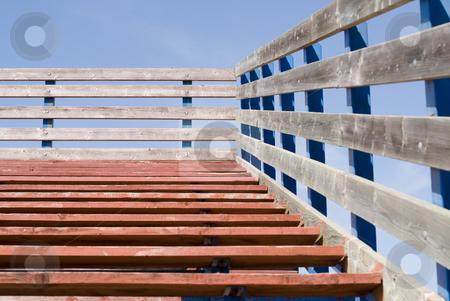 School Bleachers stock photo, A set of wooden bleaches shot from at the bottom by Richard Nelson