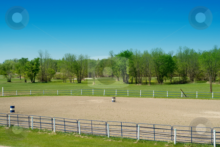 Rodeo Grounds stock photo, A gravel pit used for the rodeo complete with barrels by Richard Nelson