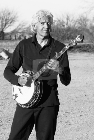 Banjo Player stock photo, Banjo player with his instrument in a rural setting by Scott Griessel