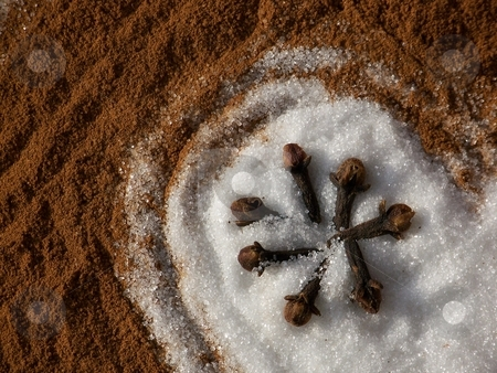 White granulated sugar on cinnamon stock photo, Image of white granulated sugar on cinnamon with cloves. by Jill Oliver